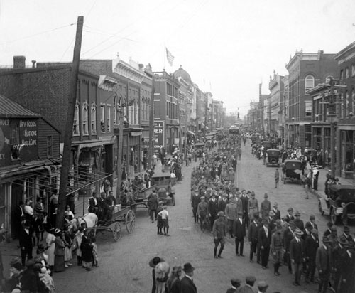 Black and white photo of a parade through downtown Charlottesville